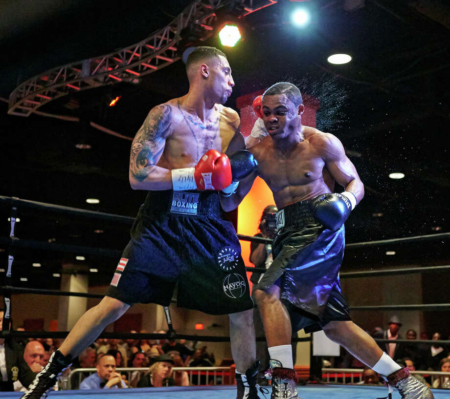 Frank Galarza, left, fights with Jason Thompson in a junior-middleweight boxing match on Saturday, May 4, in Queens, N.Y. Galarza, who is managed by A.J. Galante and Danbury-based Elite Boxing Enterprises, has been training in Danbury under the watchful eye of trainer Fernely Feliz. Must Credit: David Spagnolo Photo: Contributed Photo, Contributed Photo/David Spagnolo / The News-Times Contributed