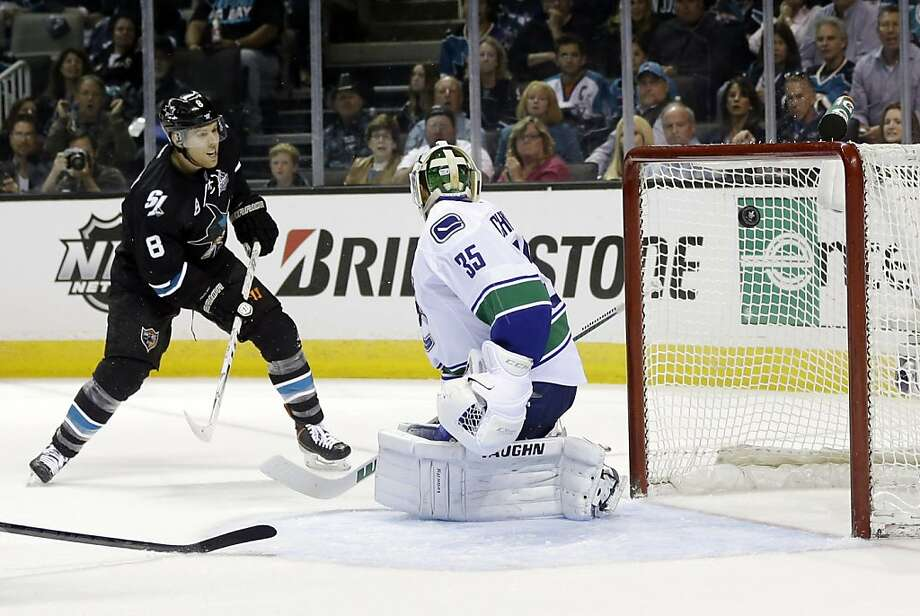 Joe Pavelski scores the first goal of Game 3 against Vancouver's Cory Schneider, who might be back between the pipes Tuesday night. Photo: Marcio Jose Sanchez, Associated Press