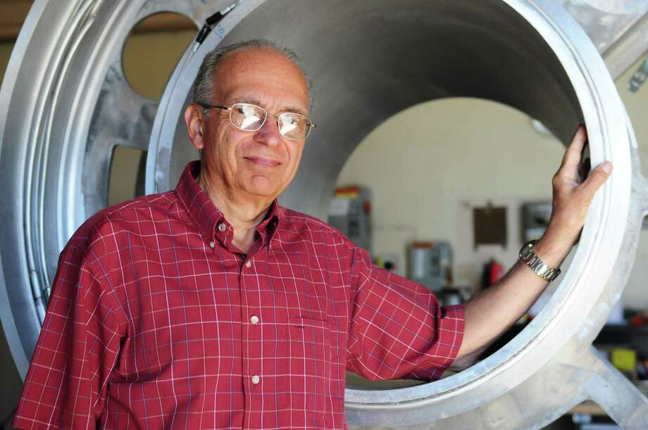 General Electric Co. Global Research chief engineer, Trifon Laskaris, stands next to a 3-tesla Magnetic Resonance Imaging (MRI) scanner, used for scanning heads only, which he is process of building, Monday May 6, 2013, at GE Global Research in Niskayuna, N.Y. Laskaris was recently awarded his 200th U.S. patent. The 3-T scanner would mark 201 patents, and he has another 25 pending. (Will Waldron/Times Union) Photo: Will Waldron