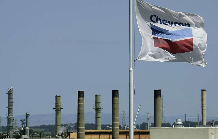 FILE - This April 21, 2008 file photo shows a Chevron flag flying over the Chevron refinery in Richmond, Calif. Chevron Corp. reports quarterly financial results before the market opens on Friday, April 26, 2013. (AP Photo/Ben Margot, File) Photo: Ben Margot, Associated Press