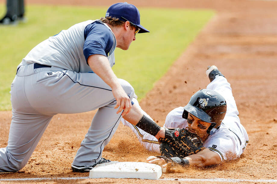 Rico Noel of the Missions is picked off first base on a tag by Corpus Christi's Zach Johnson in the first inning of Monday's shutout loss to the Hooks. Photo: Photos By Marvin Pfeiffer / San Antonio Express-News