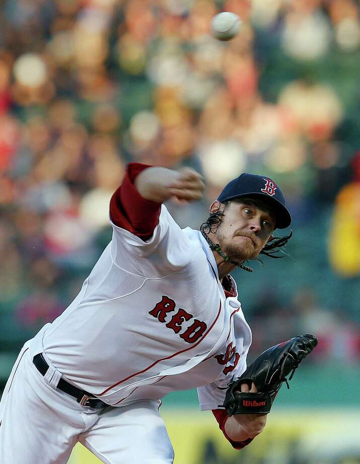 BOSTON, MA - MAY 6:  Clay Buchholz #11 of the Boston Red Sox throws against the Minnesota Twins in the first inning at Fenway Park on May 6, 2013 in Boston, Massachusetts.  (Photo by Jim Rogash/Getty Images) Photo: Jim Rogash, Stringer / 2013 Getty Images
