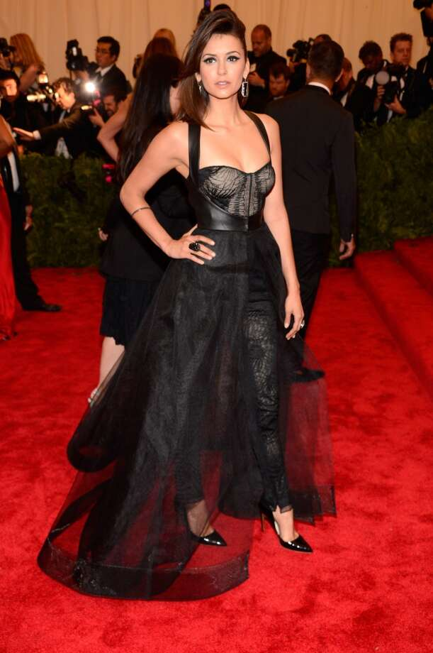 """NEW YORK, NY - MAY 06:  Nina Dobrev attends the Costume Institute Gala for the """"PUNK: Chaos to Couture"""" exhibition at the Metropolitan Museum of Art on May 6, 2013 in New York City.  (Photo by Kevin Mazur/WireImage)"""