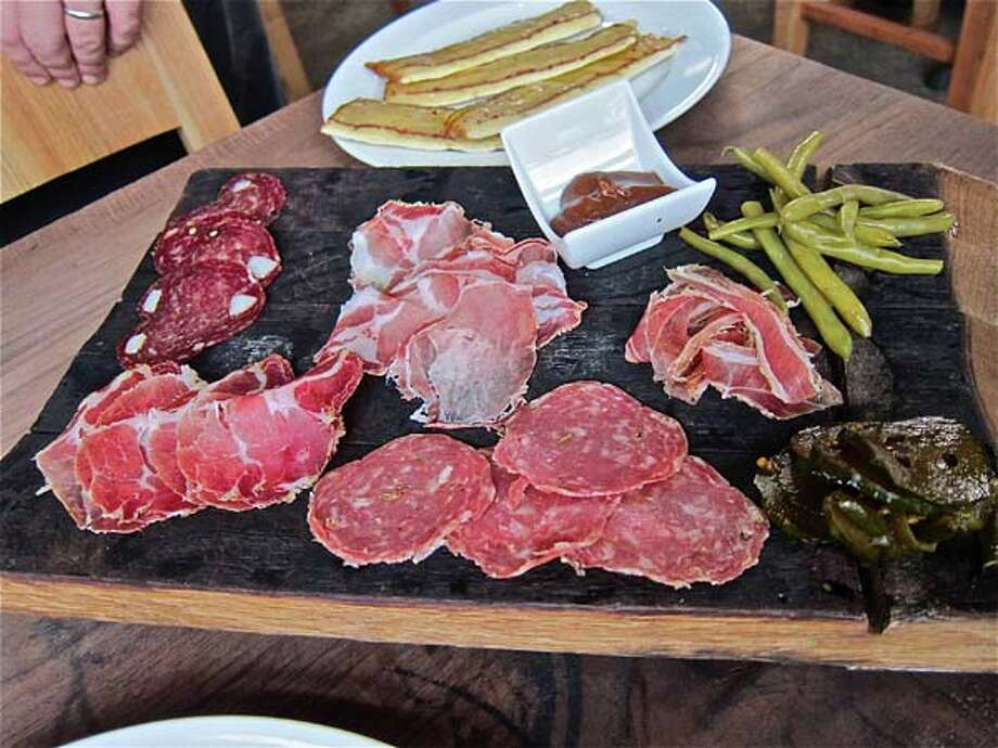 A house cured salumi platter at Underbelly, clockwise from upper right: pancetta, finocchio, coppa, wild boar sausage, lonza. Photo: Alison Cook, Houston Chronicle