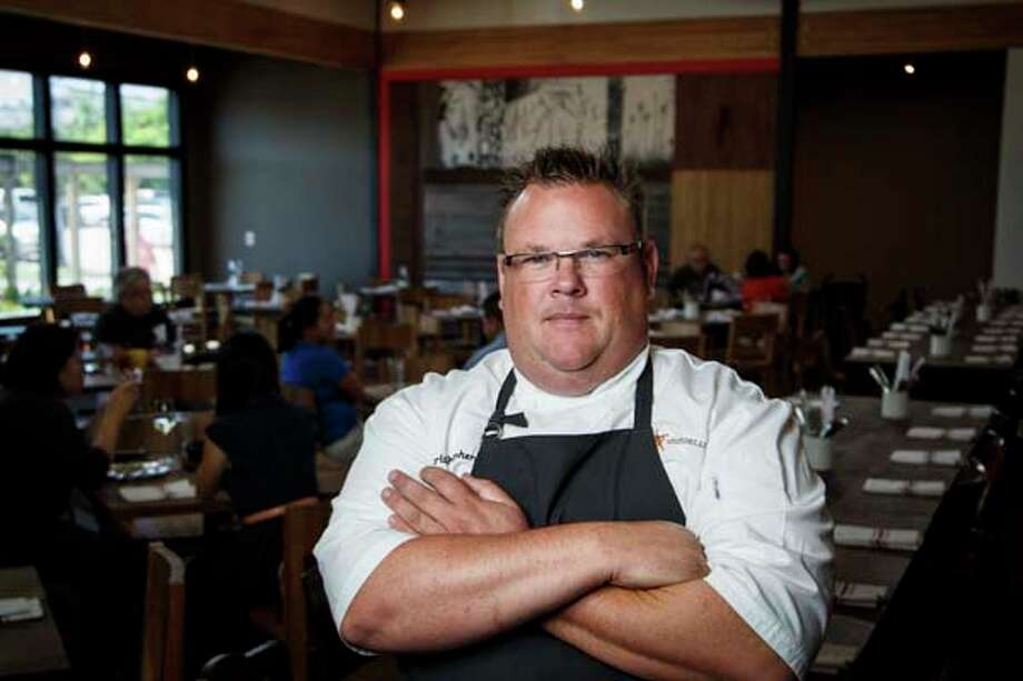 Chris Shepherd poses for a photo in his restaurant Underbelly, Monday, April 22, 2013, in Houston.  Shepherd is a nominee for best chef Southwest for the 2013 James Beard Foundation awards on May 6.  ( Michael Paulsen / Houston Chronicle ) Photo: Michael Paulsen, Houston Chronicle / © 2013 Houston Chronicle