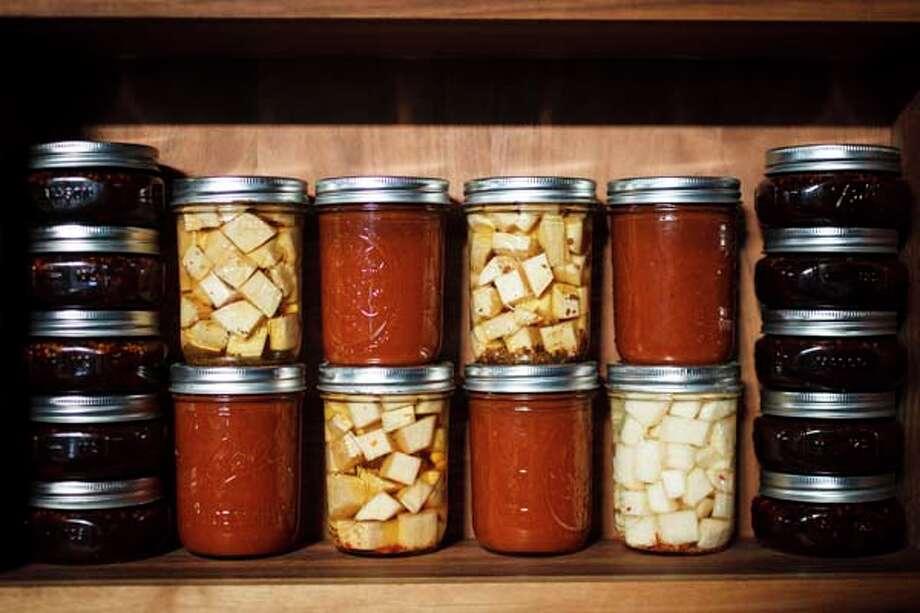 Canned goods at Chris Shepherd's restaurant Underbelly, Friday, Sept. 21, 2012, in Houston. ( Michael Paulsen / Houston Chronicle ) Photo: Michael Paulsen, Houston Chronicle / © 2012 Houston Chronicle