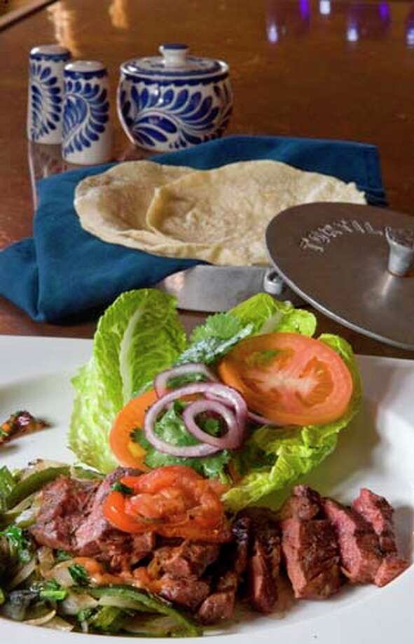 Bistec encebollado with fresh salad is a featured dish at Hugo's Photo: Steve Campbell, Houston Chronicle / Houston Chronicle