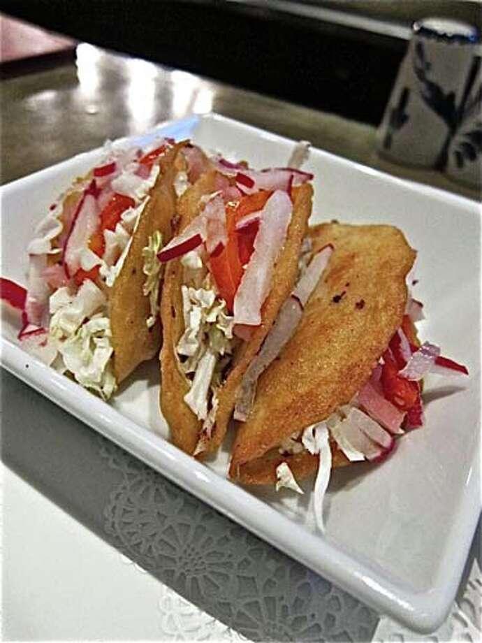 Hugo's Tacos Dorados de Papas. Photo: Alison Cook, Houston Chronicle