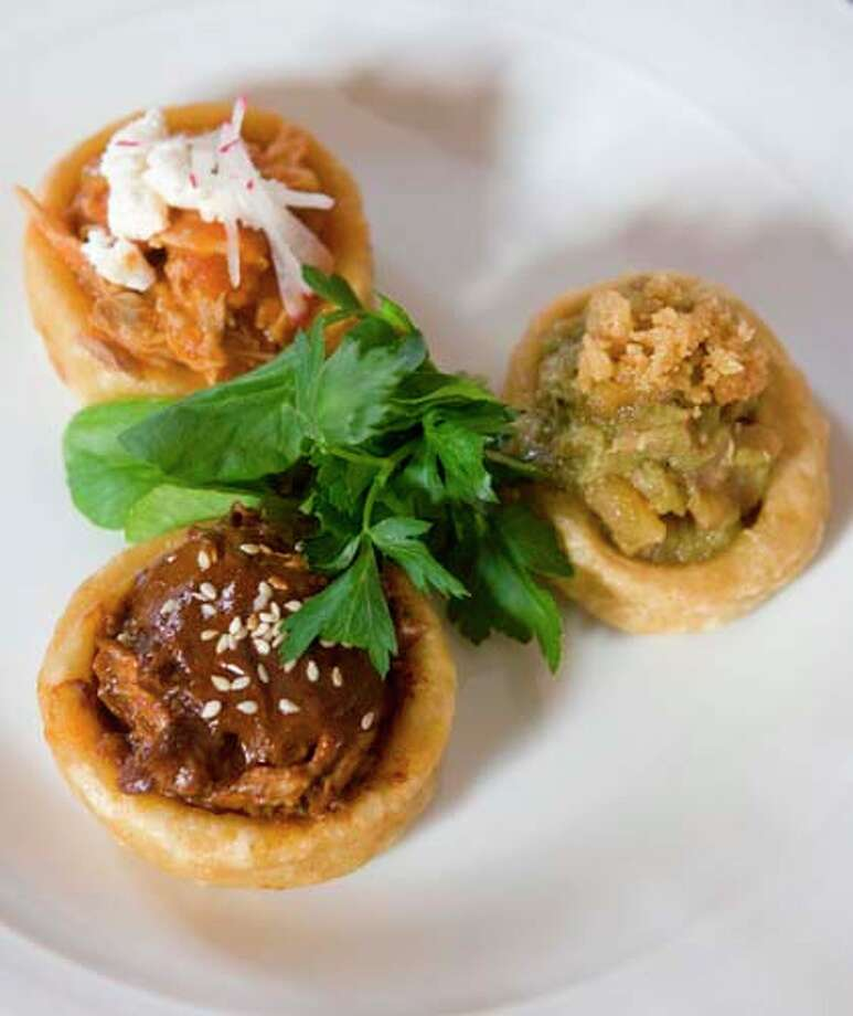 Duck mole, rabbit tinga and pork cracklings in salsa verde are a featured dish at Hugo's. Photo: Steve Campbell, Houston Chronicle / Houston Chronicle