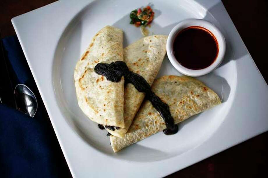 Hugo's appetizer: Mushroom and Corn Fungus Quesadillas. Photo: Michael Paulsen, Houston Chronicle / Houston Chronicle