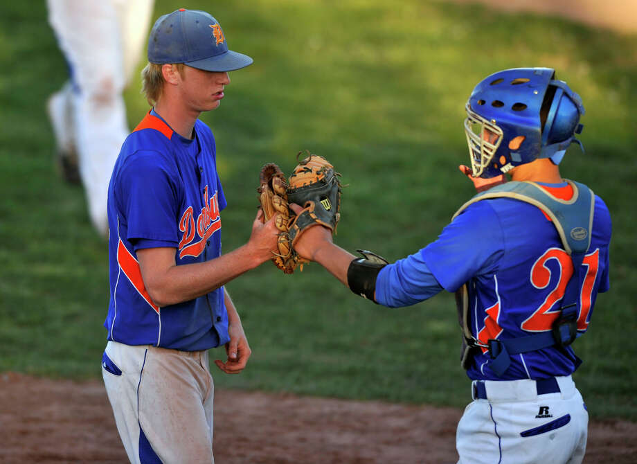 Danbury relief pitcherCory Brosz, left, is congratulated by catcher Mike Schweitzer after the final out of their game against Westhill at Westhill High School in Stamford on Monday, May 6, 2013. Danbury won, 13-9. Photo: Jason Rearick / Stamford Advocate