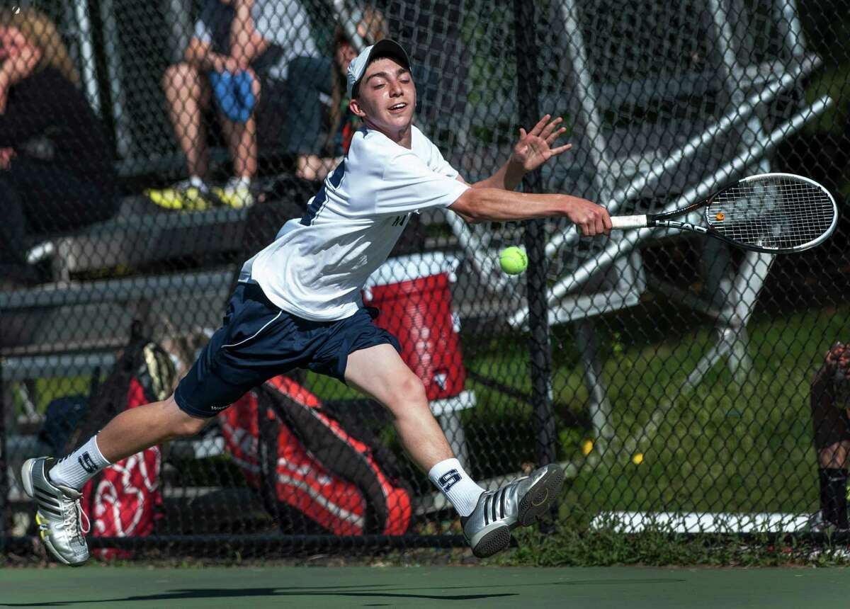 Staples high school's Joshua Moskovitz returning a shot during a boys tennis match against Greenwich high school's Zach Niklaus played at Staples high school, Westport, CT on Monday May 6th 2013.