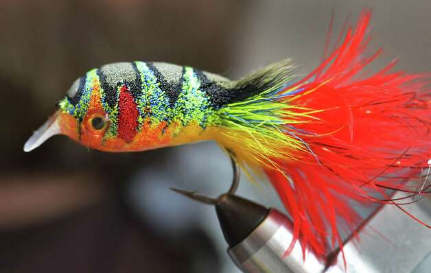 Fly tyer Pat Cohen's Crank, a stacked deer hair fly designed to move like a crank bait, at Cohen's Cobleskill studio Wednesday April 3, 2013.   (John Carl D'Annibale / Times Union) Photo: John Carl D'Annibale / 10021804A