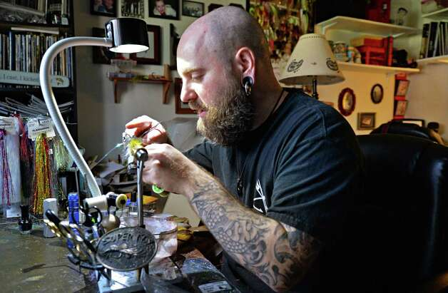 Fly tyer Pat Cohen at the work bench in his Cobleskill studio Wednesday April 24, 2013.  (John Carl D'Annibale / Times Union) Photo: John Carl D'Annibale / 10021804A