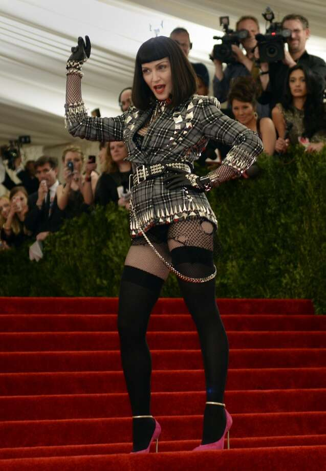 Madonna arrives at the Metropolitan Museum of Art's Costume Institute Gala benefit in honor of the museum?s latest exhibit, ?Punk: Chaos to Couture.? May 6, 2013 in New York. AFP PHOTO/Timothy A. CLARY        (Photo credit should read TIMOTHY A. CLARY/AFP/Getty Images)
