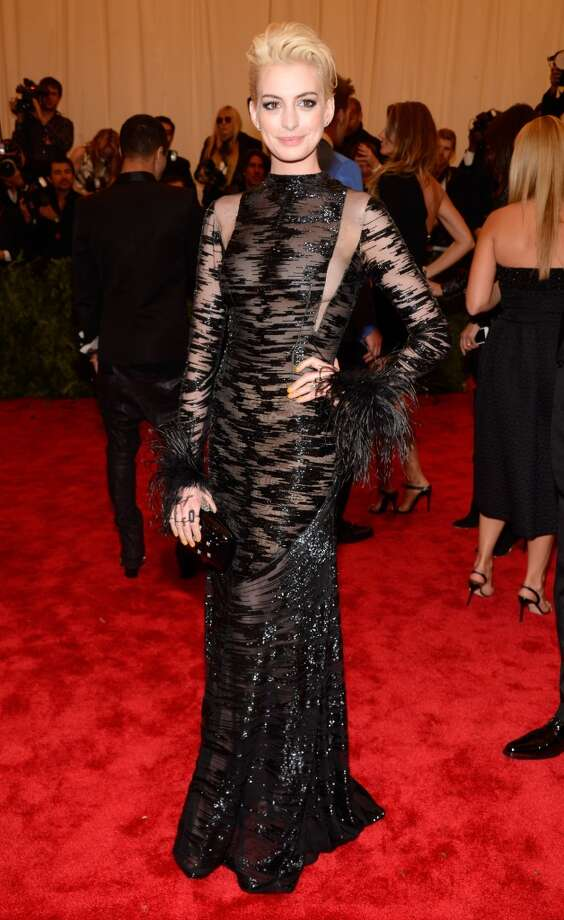 """NEW YORK, NY - MAY 06:  Anne Hathaway attends the Costume Institute Gala for the """"PUNK: Chaos to Couture"""" exhibition at the Metropolitan Museum of Art on May 6, 2013 in New York City.  (Photo by Kevin Mazur/WireImage)"""