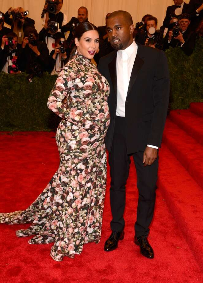 "NEW YORK, NY - MAY 06:  Kim Kardashian and Kanye West attend the Costume Institute Gala for the ""PUNK: Chaos to Couture"" exhibition at the Metropolitan Museum of Art on May 6, 2013 in New York City.  (Photo by Kevin Mazur/WireImage)"