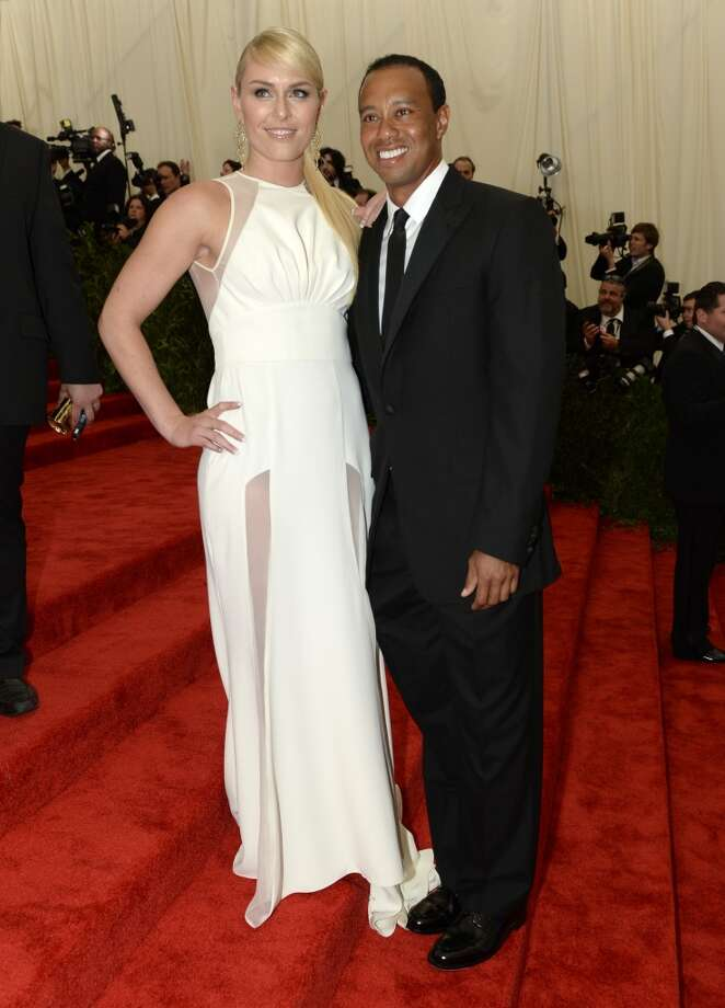 World Cup skier Lindsey Vonn (L) and golfer Tiger Woods (R) arrive at the Metropolitan Museum of Art's Costume Institute Gala benefit in honor of the museum?s latest exhibit, ?Punk: Chaos to Couture ? May 6, 2013 in New York. AFP PHOTO/Timothy A. CLARY        (Photo credit should read TIMOTHY A. CLARY/AFP/Getty Images)