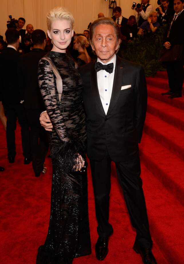 "NEW YORK, NY - MAY 06:  Anne Hathaway and Valentino Garavani attend the Costume Institute Gala for the ""PUNK: Chaos to Couture"" exhibition at the Metropolitan Museum of Art on May 6, 2013 in New York City.  (Photo by Kevin Mazur/WireImage)"