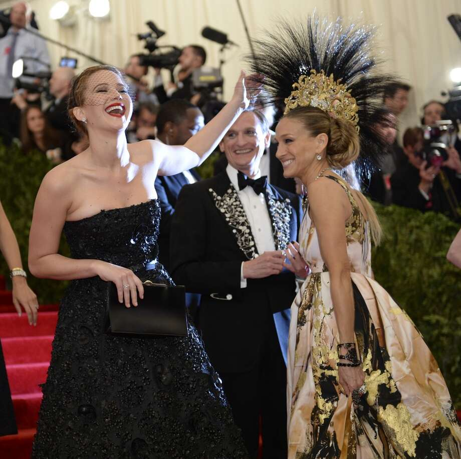 Actresses Jennifer Lawrence (L) and Sarah Jessica Parker (R) arrive at the Metropolitan Museum of Art's Costume Institute Gala benefit in honor of the museum?s latest exhibit, ?Punk: Chaos to Couture? on May 6, 2013 in New York. AFP PHOTO/Timothy A. CLARY        (Photo credit should read TIMOTHY A. CLARY/AFP/Getty Images)
