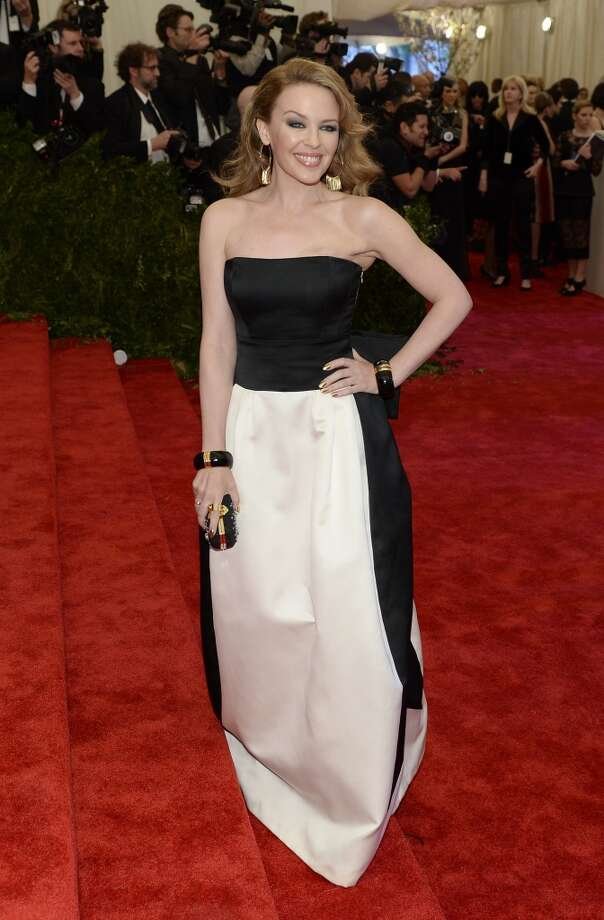 Australian actress and singer Kylie Minogue arrives at the Metropolitan Museum of Art's Costume Institute Gala benefit in honor of the museum?s latest exhibit, ?Punk: Chaos to Couture?, on May 6, 2013 in New York. AFP PHOTO/Timothy A. CLARY        (Photo credit should read TIMOTHY A. CLARY/AFP/Getty Images)