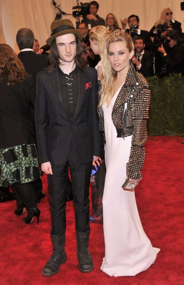 "NEW YORK, NY - MAY 06:  Tom Sturridge and Sienna Miller attend the Costume Institute Gala for the ""PUNK: Chaos to Couture"" exhibition at the Metropolitan Museum of Art on May 6, 2013 in New York City.  (Photo by Stephen Lovekin/FilmMagic)"