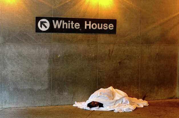 "A man rests on the floor at a metro station in downtown Washington on May 6, 2013. A solid job creation report for April and a fall in the jobless rate to 7.5 percent sweetened the picture for the US economy, amid worries that it has tumbled into a ""spring swoon.""    AFP PHOTO/Jewel Samad Photo: JEWEL SAMAD, AFP/Getty Images / AFP"