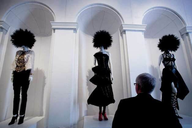 "A visitor views the Metropolitan Museum of Art's exhibit, ""Punk: Chaos to Couture,"" Monday, May 6, 2013 in New York. The show, which examines punk's impact on high fashion from the movement's birth in the 1970s through its continuing influence today, is open May 9 through August 14. (AP Photo/Mark Lennihan) Photo: Mark Lennihan, Associated Press / AP"