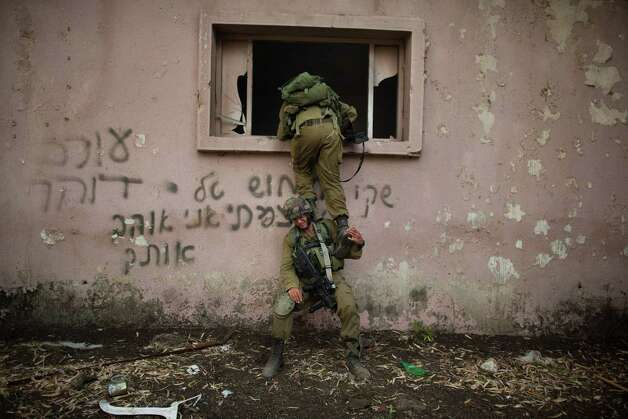 A Israeli soldiers of the Golani brigade take part in an exercise near the border with Syria  on May 6, 2013  at the Israeli-annexed Golan Heights. Syria has accused Israel of launching a series of airstrikes on targets near the Lebanon/Syria border, including an arms shipment and the Jamraya research centre, that was thought to produce chemical weapons. Photo: Uriel Sinai, Getty Images / 2013 Getty Images