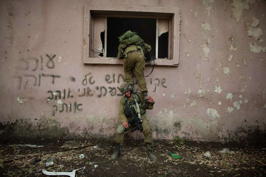 A Israeli soldiers of the Golani brigade take part in an exercise near the border with Syria  on May