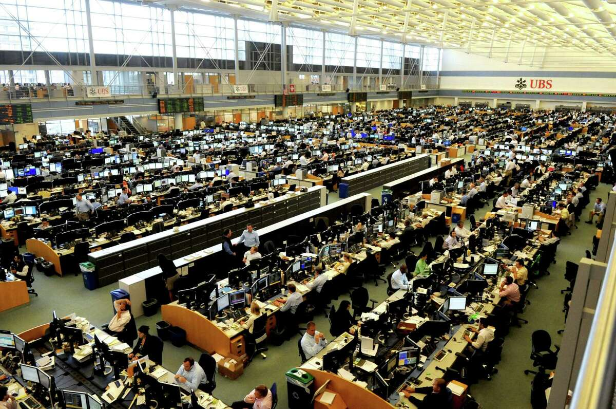 The trading room floor in the UBS building in Stamford. UBS is cutting about 10,000 jobs and will move much of its New York-area operations out of the space at 299 Park Ave. in Manhattan and into the building in Stamford, as well as another UBS space at 1285 Avenue of the Americas in New York City.