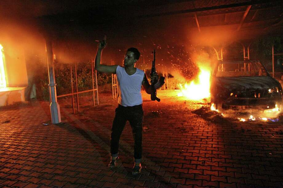 The attacks on the U.S. Embassy and CIA annex in Benghazi on Sept. 11, 2012, killed four Americans: Ambassador Christopher Stevens and another State Department officer, Sean Smith, and former Navy SEALs Tyrone Woods and Glen Doherty. Photo: Getty Images