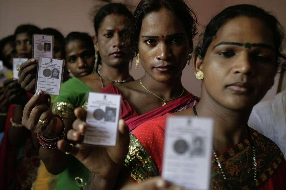 Indian eunuchs hold up their voter cards at a function in Bhubaneswar in the Indian state of Orissa, Monday, May 6, 2013. Nearly 175 voter cards were distribute to transgender and eunuchs for the first time in the state so that they can participate in next year upcoming state elections. (AP Photo/Biswaranjan Rout) Photo: Biswaranjan Rout