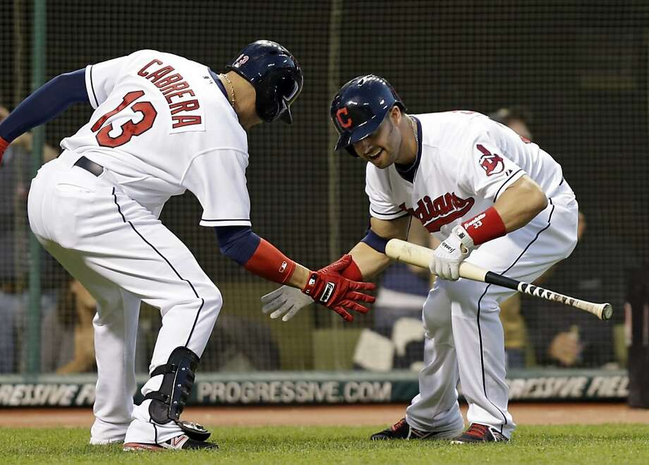 Cleveland's Nick Swisher (right) greets Asdrubal Cabrera after Cabrera hit a solo home run to lead off the fifth inning. Photo: Mark Duncan, Associated Press