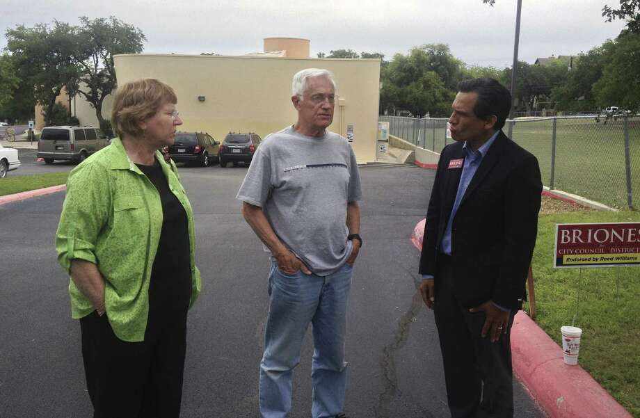 Mary and Jerry McKinney (from left) talk with District 8 City Council candidate Rolando Briones at the Cody Public Library polling place. Photo: Sarah Tressler / San Antonio Express-News