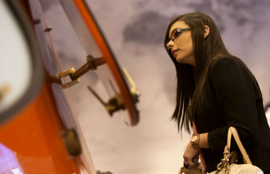 Kaitlyn Parker looks at a life boat during the Offshore Technology Conference at Reliant Center Monday, May 6, 2013, in Houston. (Cody Duty / Houston Chronicle)
