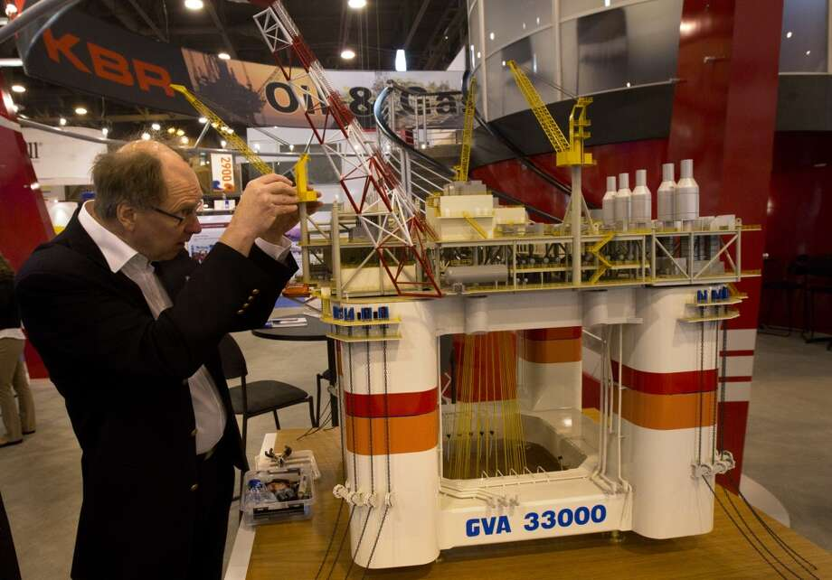 Peter Ankarsward with GVA, fixes a model oil platform before during the Offshore Technology Conference at Reliant Center Monday, May 6, 2013, in Houston. (Cody Duty / Houston Chronicle) Photo: Cody Duty, Houston Chronicle