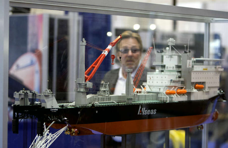 A man walks by a Lorelay DP Pipelay Vessel during the Offshore Technology Conference at Reliant Center Monday, May 6, 2013, in Houston. (Cody Duty / Houston Chronicle)