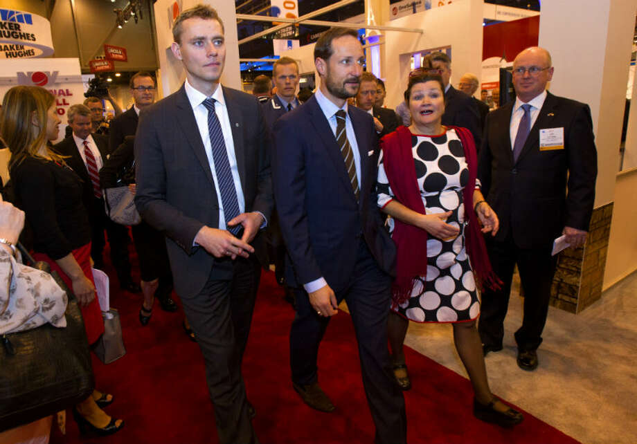 Norwegian petroleum minister Ola Borten Moe, left, walks with Norway's Crown Prince Haakon, center, right, during the Offshore Technology Conference at Reliant Center Monday, May 6, 2013, in Houston. (Cody Duty / Houston Chronicle)