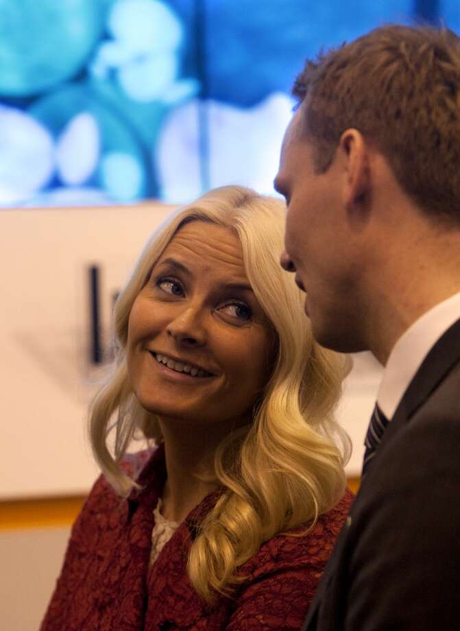 Norwegian Princess Mette-Marit, left, talks with Norwegian petroleum minister Ola Borten Moe, right, during the Offshore Technology Conference at Reliant Center Monday, May 6, 2013, in Houston. (Cody Duty / Houston Chronicle) Photo: Cody Duty, Houston Chronicle