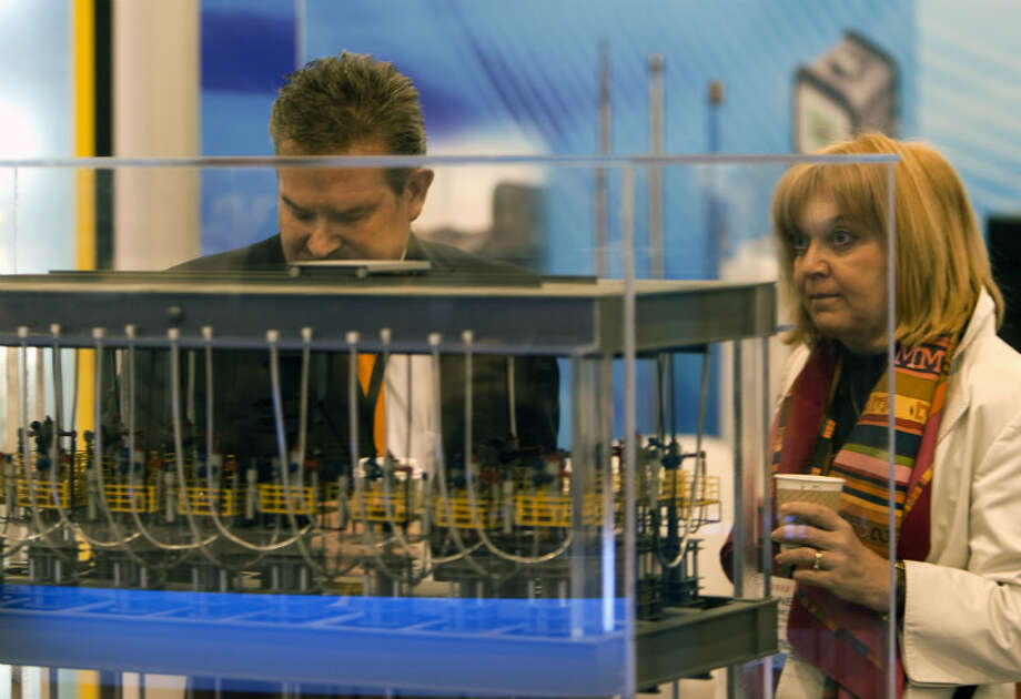 Randy Jordan, left, and Anne Guerin-Moens, right, looks at a Drilling Riser, during the Offshore Technology Conference at Reliant Center Monday, May 6, 2013, in Houston. (Cody Duty / Houston Chronicle)