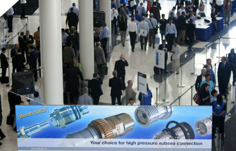 Attendees make their way during the Offshore Technology Conference at Reliant Center Monday, May 6, 2013, in Houston. (Cody Duty / Houston Chronicle)