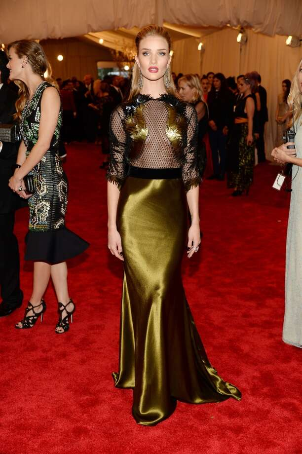 "NEW YORK, NY - MAY 06:  Rosie Huntington-Whiteley attends the Costume Institute Gala for the ""PUNK: Chaos to Couture"" exhibition at the Metropolitan Museum of Art on May 6, 2013 in New York City.  (Photo by Dimitrios Kambouris/Getty Images)"