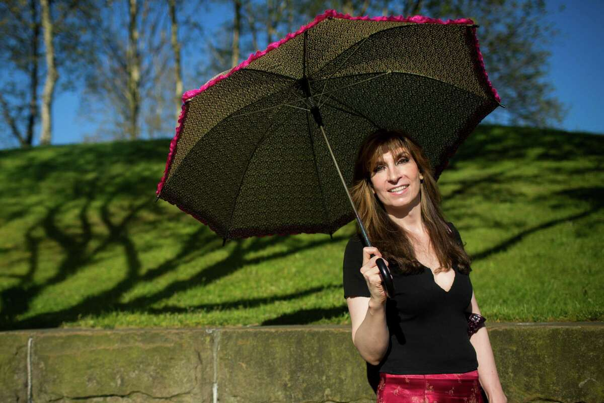 Nikki Lee Taylor, a Seattle-local filmmaker, shows off her summer fashion Monday, May 6, 2013, on Capitol Hill in Seattle.