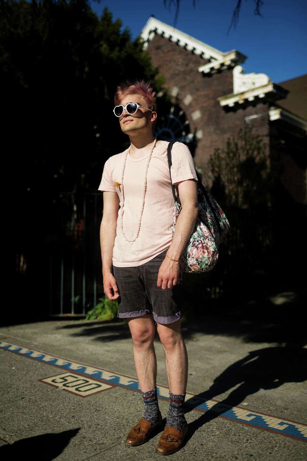 Andrew Schultz shows off his spunky summer fashion Monday, May 6, 2013, on Capitol Hill in Seattle.