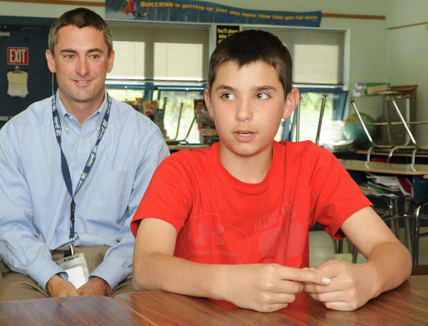 Sixth grader Calvin Fluegge, 11, talks about a new approach to teaching and learning at Boght Elementary School on Monday, May 6, 2013 in Colonie, N.Y. Sixth grade teacher Pete Hanrahan sits next to him.  (Lori Van Buren / Times Union) Photo: Lori Van Buren / 10022284A