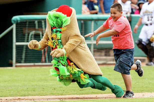A young Missions' fan takes down the Puffy Taco on his way to home plate during the Missions' game with the Corpus Christi Hooks at Wolff Stadium on Monday, May 6, 2013.  MARVIN PFEIFFER/ mpfeiffer@express-news.net