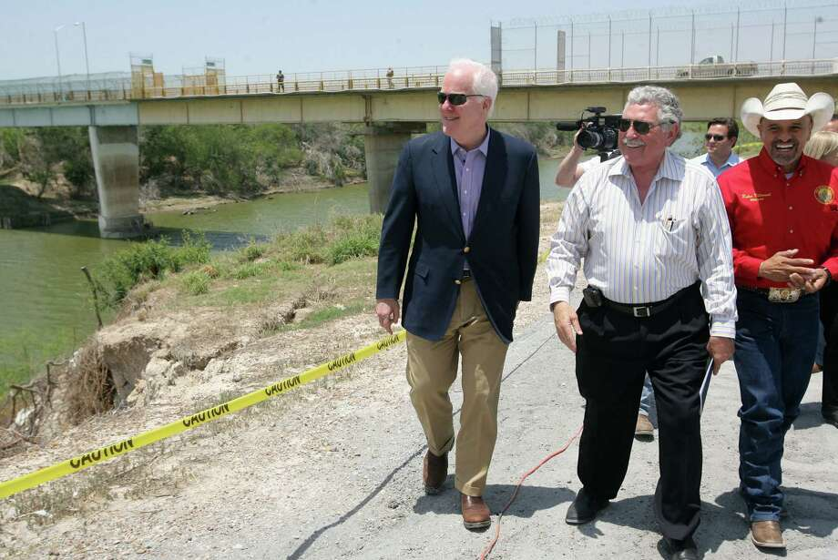 U.S. Sen. John Cornyn (from left); Sam Vale, owner of the Starr-Camargo International Bridge; and Rio Grande City mayor Ruben Villarreal walk near the bridge while discussing border issues. Rio Grande Valley officials are hoping for measures to facilitate cross-border trade. Photo: Associated Press