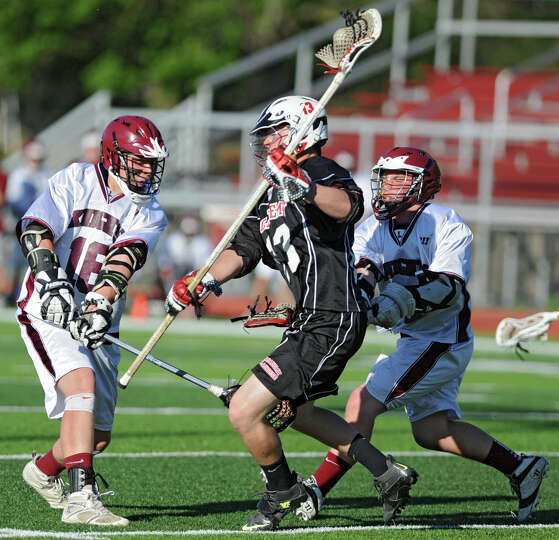 Albany Academy's Connor Flood, center, runs past Lansingburgh's Aaron Hansbury, left, and Jon Gilber