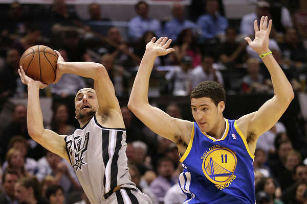San Antonio Spurs' Manu Ginobili is fouled by Golden State Warriors' Klay Thompson during the first half of Game 1 in the NBA Western Conference semifinals at the AT&T Center, Monday, May 6, 2013.